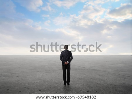 Businessman observing the desert in front of him