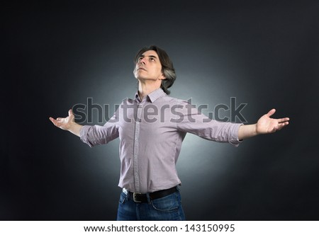 Businessman of freedom open arms - stock photo