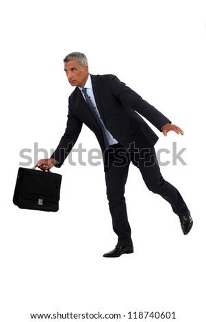 Businessman off-balance - stock photo