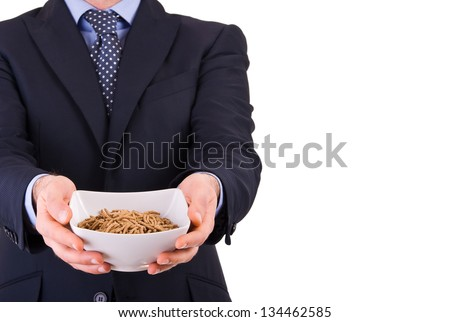 Businessman offering a cereal bowl. - stock photo