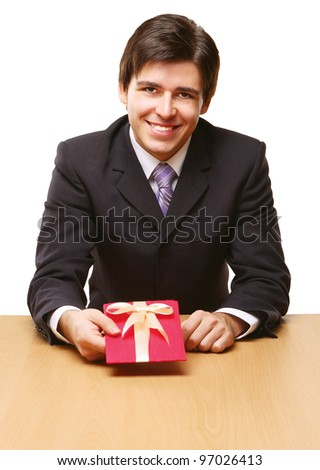 Businessman offering a gift to you - stock photo