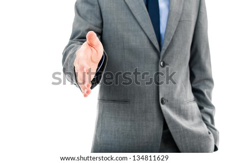 Businessman offering for handshake - stock photo