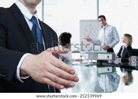 Businessman offering handshake to you  - stock photo