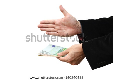 Businessman offering handshake with money - stock photo
