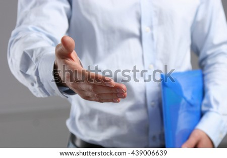 Businessman offering his hand for handshake.
