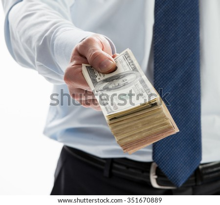 Businessman offering money to you, closeup shot