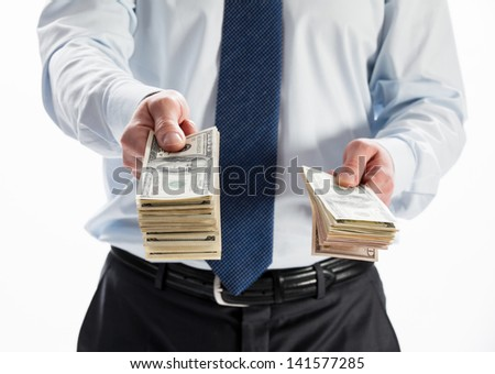 Businessman offering money to you on white background - stock photo