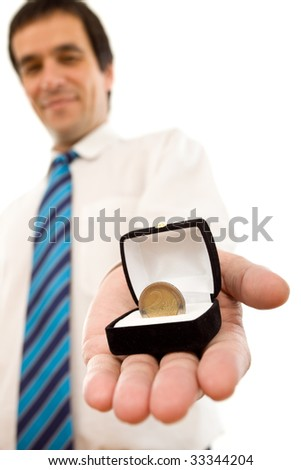 Businessman offering one euro coin in a jewel gift box - isolated success concept - stock photo