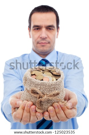 Businessman offering you a bag of money - various euro coins - stock photo