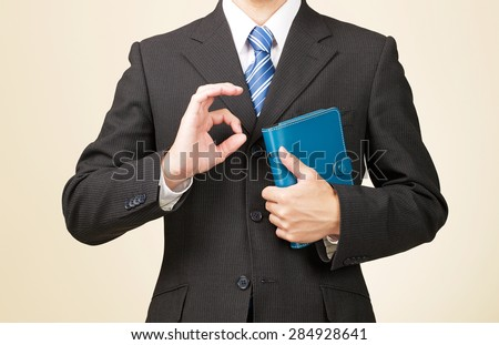 businessman OK sign gesture