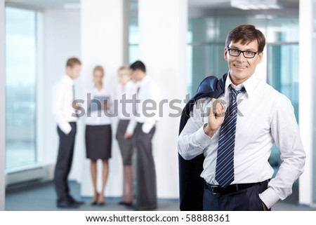 Businessman on a background of office staff - stock photo