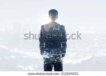 businessman on a city background - stock photo