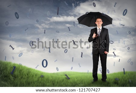 Businessman on a field with binary code falling