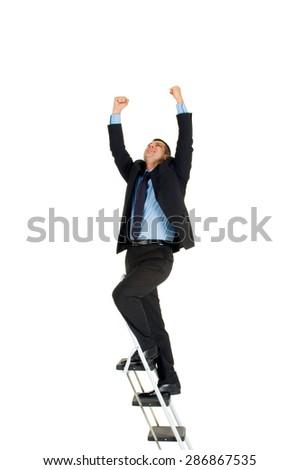 businessman on a ladder - stock photo
