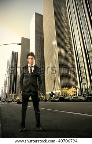 businessman on a New York city street - stock photo