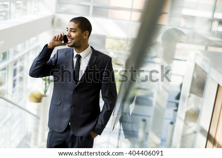 Businessman on a phone walking in the office