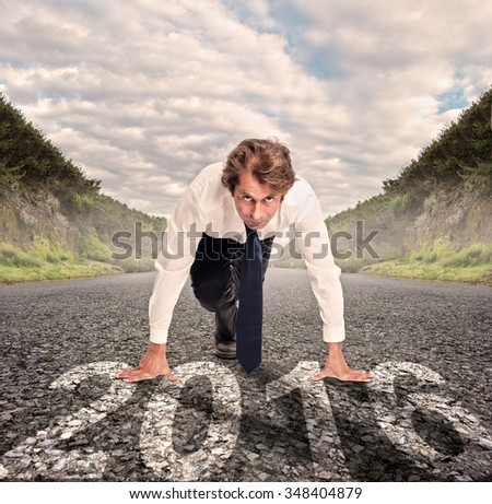 businessman on a road with year 2016 painted on it - stock photo