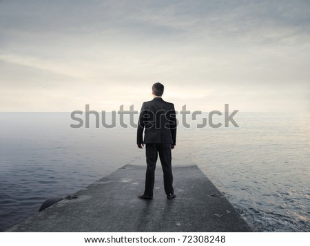 Businessman on a wharf - stock photo