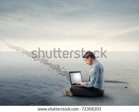 Businessman on a wharf using a laptop and numbers flying away from it - stock photo