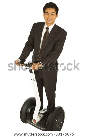Businessman on an alternative transport vehicle - stock photo