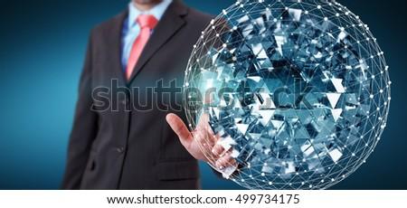 Businessman on blurred background touching flying abstract sphere with shiny cube 3D rendering
