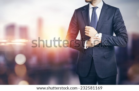 Businessman on blurred city background - stock photo