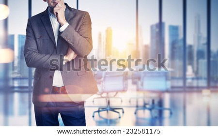 Businessman on blurred office background - stock photo