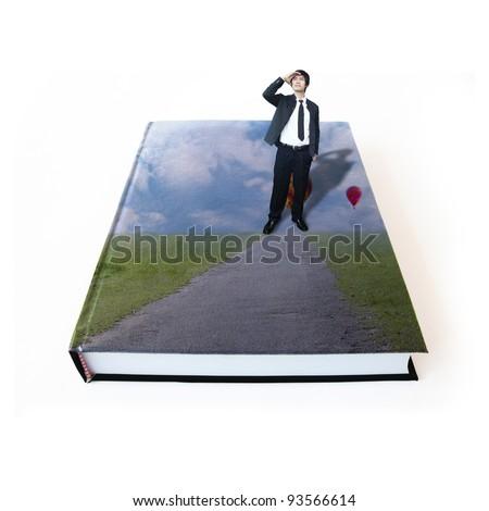 Businessman on book - stock photo
