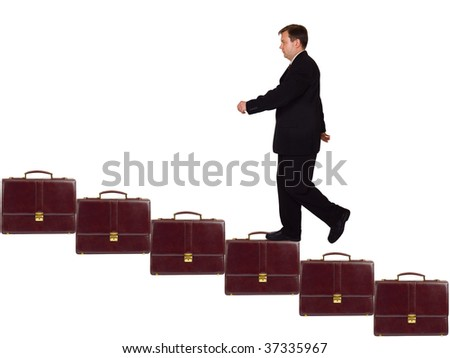 Businessman on career staircase isolated on white background - stock photo