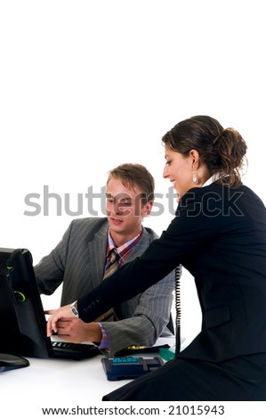 Businessman on computer with assistant making phone call  in the office.  Studio, white background
