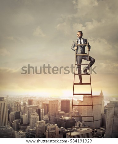 businessman on high stairs