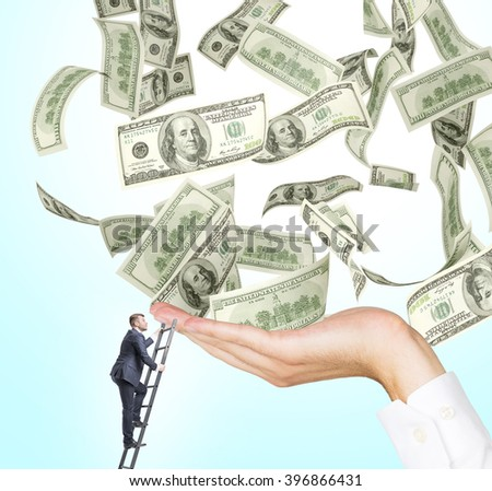 Businessman on ladder trying to reach hand with dollars. Concept of career growth. - stock photo