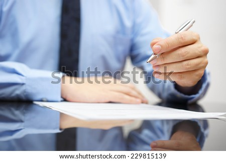 Businessman on meeting is commenting document - stock photo