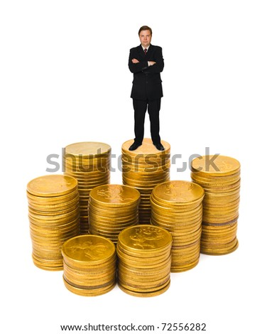 Businessman on money stacks isolated on white background - stock photo