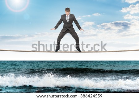 Businessman on rope