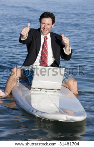 Businessman on Surfboard - stock photo