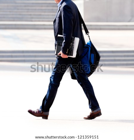 Businessman on the background of the office. The modern business man. - stock photo