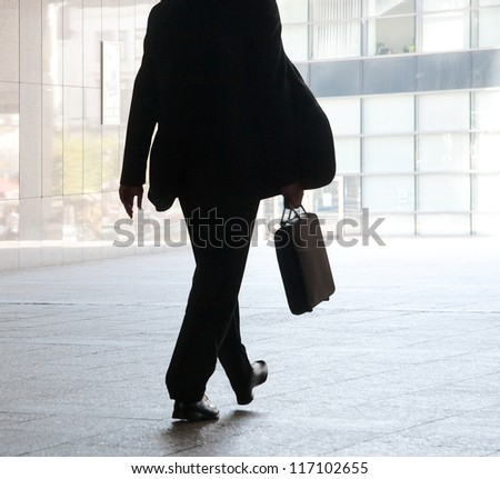 Businessman on the background of the office. The modern businessman. - stock photo