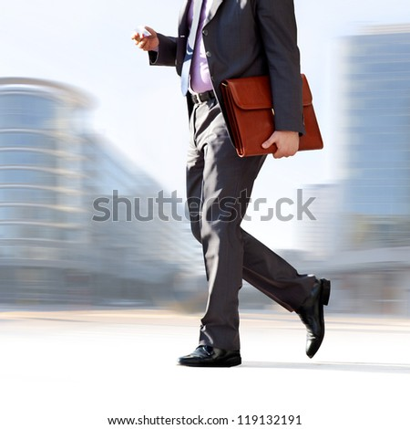 Businessman on the background of the office. The modern businessman.