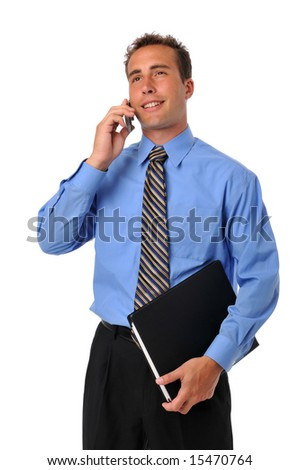 Businessman on the cellphone and holding a portfolio - stock photo
