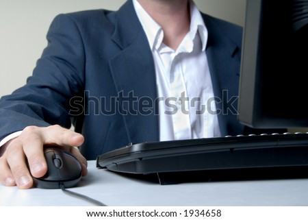 businessman on the computer with mouse