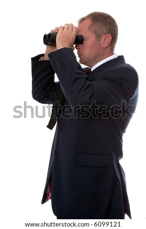 Businessman on the lookout for something using a pair of binoculars.