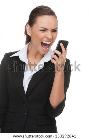 Businessman on the phone. Angry young businessman shouting on the mobile phone while isolated on white - stock photo