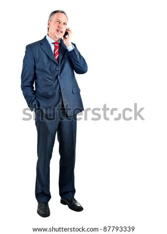 Businessman on the phone full length - stock photo