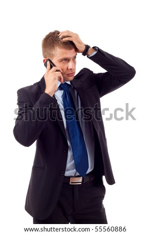 businessman on the phone with hand on his head, receiving bad news - stock photo