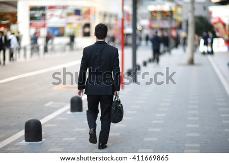 Businessman on the streets of Megalopolis - stock photo