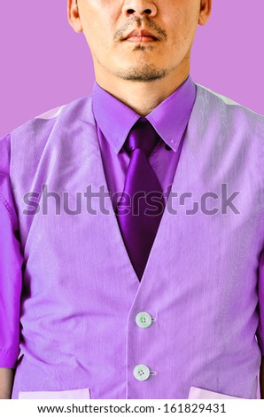 businessman on violet background - stock photo