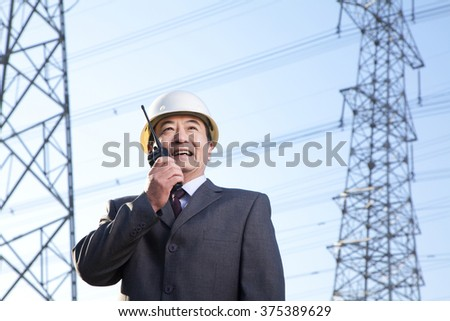 Businessman on Walkie Talkie - stock photo