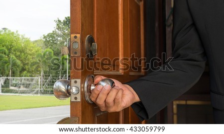 businessman open the wood door to local soccer stadium - can use to display or montage on product or concept of sport life   - stock photo