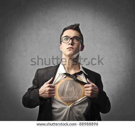 Businessman opening his skirt and showing an euro coin on his chest - stock photo